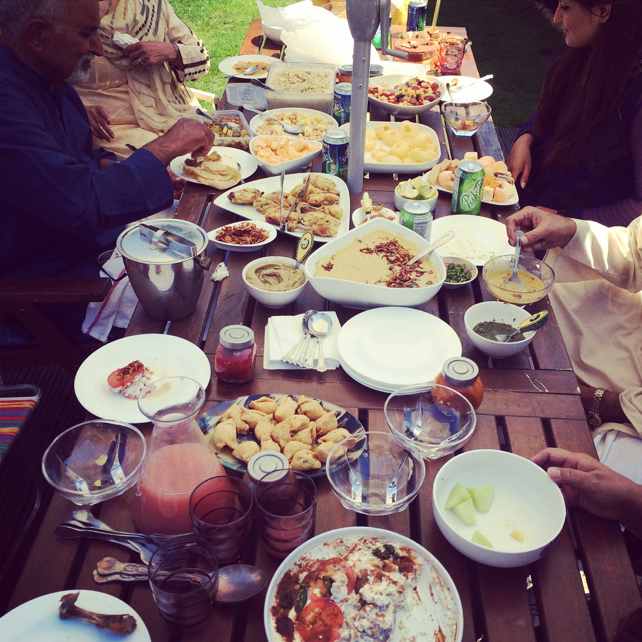 The Family Socials - Sharing platters of food around a table together